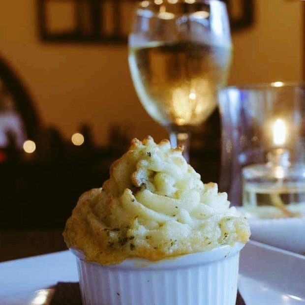 Braised oxtail cottage pie topped with a broccoli & cheddar mash
