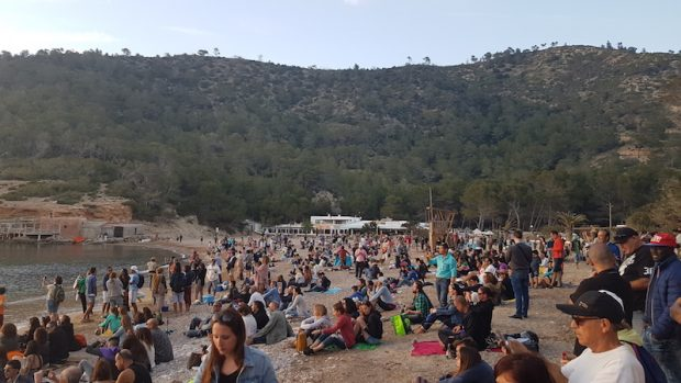 The crowds enjoying the sunset and drums on Benirras Beach Ibiza