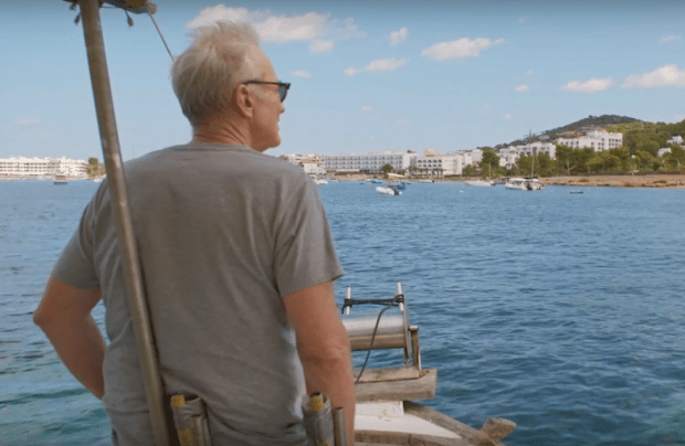Larry Lamb on a traditional Ibiza fishing boat