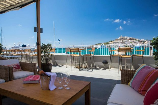 Cappuccino Grand Cafe Ibiza with the iconic view across the marina to Dalt Vila