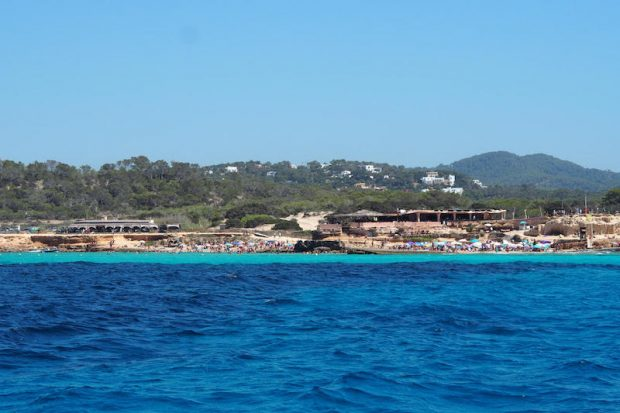 Cala Comte Ibiza from the sea with its beautiful crystal clear turquoise waters